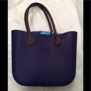 Dark purple OBag with leather handles. Super cute!